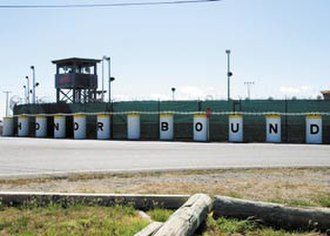 "Joint Task Force Guantanamo - The wall has been painted with part of the motto ""Honor Bound."""