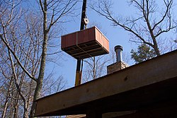 Using a crane is a common method of installing a one piece hot tub
