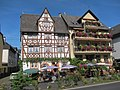 Hotel restaurant in traditional wooden frame style. That's Eller along the Mosel river - panoramio.jpg