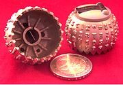 Replaceable IBM typeballs with clip, 2 Euro coin to compare