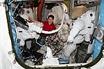 ISS-58 Anne McClain works in the Quest airlock (1).jpg