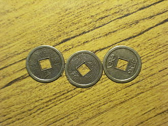 I Ching divination -  Two heads and one tail of the original I-Ching Divination Coins.