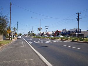 Irymple, Victoria - The Calder Highway, passing through Irymple. Approaching the level crossing on the Mildura Line.