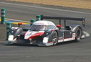 The Peugeot 908 sports prototype car being driven by Jacques Villeneuve in 2007.