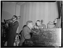 Jay Higginbotham, Pete Johnson, Red Allen, and Lester Young, National Press Club, Washington, D.C., ca. 1940. Photograph by William P. Gottlieb.