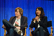 Jed Whedon and Maurissa Tancharoen sitting.