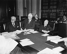Photo of Jones seated at a meeting of the Reconstruction Finance Corporation