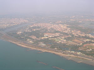 Qieding District, Kaohsiung - An aerial view of northern Qieding District where the Erren River reaches the Taiwan Strait; north of the river, in the left hinterground of the photo, is the South District of Tainan City