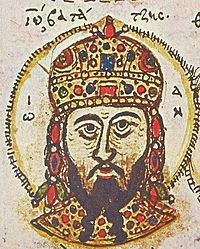 Head portrait of a middle-aged man with a dark, forked beard, wearing a golden, jewel-encrusted domed crown