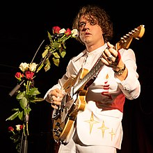 Singer-songwriter Kevin Morby performing on stage.
