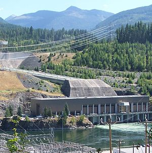 Run-of-the-river hydroelectricity - Kootenay Canal and penstocks, drop river water 84 meters to a powerhouse beside the river