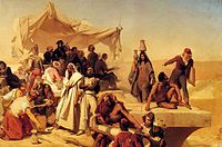 Oil painting of a desert scene by an opened tomb.  French officials in and around a tent, surrounded by Egyptians in native dress, some handling Ancient Egyptian artefacts.