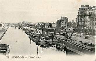 Canal Saint-Denis - Postcard by Robert Doisneau (circa 1939) showing the port of Saint-Denis on the Canal Saint-Denis on the corner of rue Denfert-Rochereau
