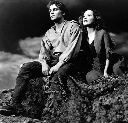 Olivier, with Merle Oberon in the 1939 film Wuthering Heights Laurence Olivier Merle Oberon Wuthering Heights.jpg