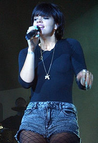 A female singing into a microphone.