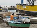 Local men by boat, Playa Blanca, Lanzarote, Canary Islands (2667771464).jpg