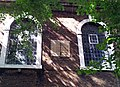 London-Woolwich, St Mary Magdalene, south windows & sundial.jpg