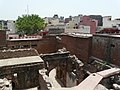 Looking over the Zafar Mahal ruins across the Mehrauli skyline (3702882637).jpg