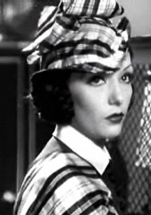 Tam (women's hat) - Lupe Velez in co-ordinated outfit and tam for the 1934 film Laughing Boy