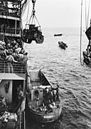 M2A4 Stuart tank is hoisted from USS Alchiba (AK-23) into a landing craft off the Guadalcanal, 7 August 1942 (80-G-10973).jpg