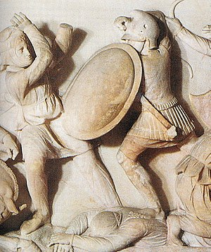 Phrygian helmet - Ancient depiction of a Macedonian infantryman (right). He is equipped with a typical Phrygian/Thracian helmet with a peak. Alexander Sarcophagus.