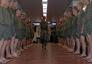 Recruit training - In August 2005, a U.S. Marine Drill Instructor inspects his platoon shortly before Lights Out at MCRD Parris Island, South Carolina.