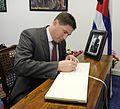 Matt Carthy signing the book of condolence to Fidel Castro at the Cuban Embassy in Dublin (31182684871).jpg