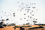 Members of the 82nd Airborne Division land after jumping from C-141B Starlifter aircraft DF-ST-88-10263.jpg