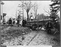 Men loading logs on a horse-drawn wagon, from the original Abraham Lincoln log cabin, at College Point, N.Y., on Feb. 21, 1906, to be re-erected on the Lincoln Farm at Hodgenville, Kentucky, LCCN2006678042.jpg