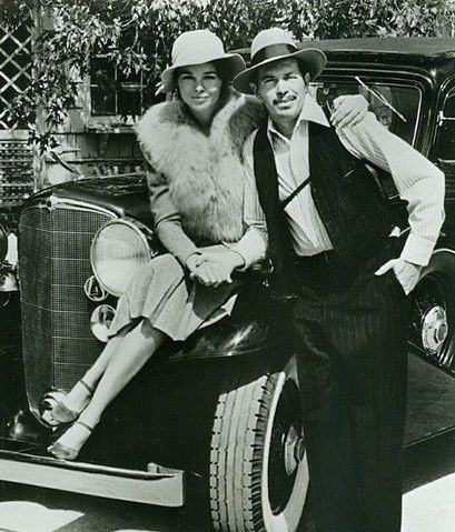 Michelle Phillips and Warren Oates Dillinger 1975.jpg