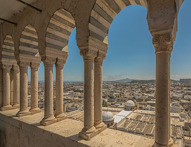 Typical view of Mosque Zitouna Through the arches of its minaret showing its two domes and medina of Tunis and the mountain Boukornin in The background: those are the three great signs showing that you are in the capital of Tunisia.