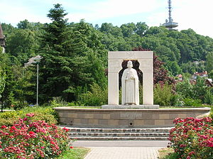 City Centre (Miskolc) - The statue of King St. Stephen. In the background: the Avas Lookout Tower, symbol of the city