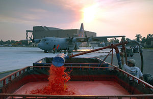 Phos-Chek - A Modular Airborne FireFighting System equipped C-130E Hercules from the 146th Airlift Wing is reloaded with Phos-Chek fire retardant to be dropped on the Simi Fire in Southern California on Oct. 28 (2003)