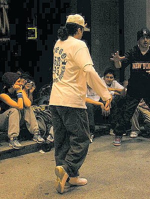 "Popping - A street dancer doing the backslide or ""moonwalk"", a common move in the floating style often seen combined with popping."