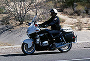 "A motor officer patrolling in Arizona on a BMW ""motor"""