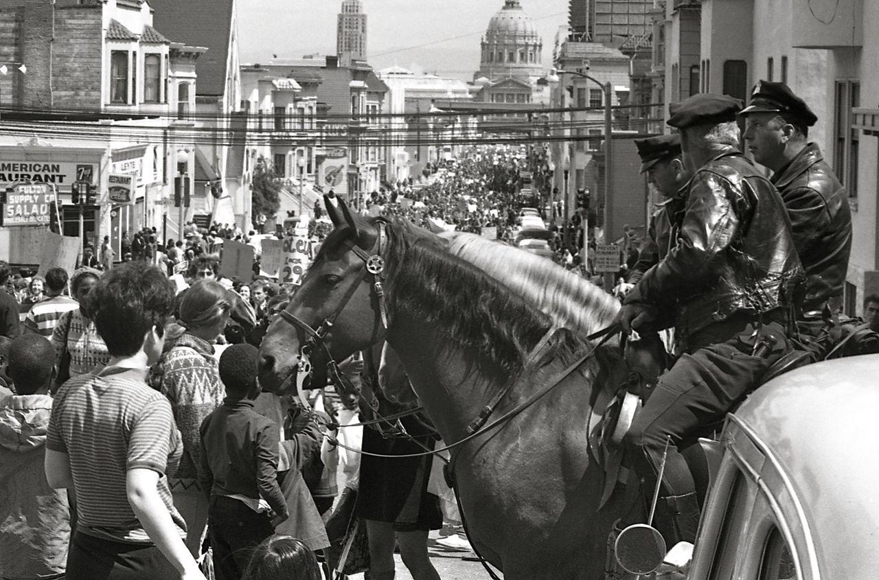 file mounted policemen watch a vietnam war protest march