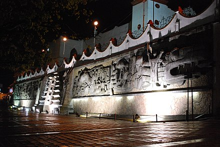Mural depicting the history of Papantla in the town square by Teodoro Cano Garcia MuralChurchCanoPap.JPG