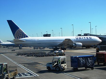 A United Airlines Boeing 767-300ER being serviced at Concourse D - Washington Dulles International Airport