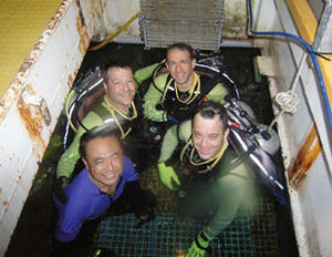 Moon pool - NEEMO 13 Crew in the wet porch/moon pool of the Aquarius habitat