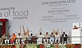 Narendra Modi addressing at the inauguration of the India Food Park, at Tumkur, in Karnataka. The Governor of Karnataka, Shri Vajubhai Rudabhai Vala, the Chief Minister of Karnataka, Shri Siddaramaiah.jpg