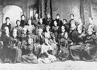 Annie Jane Schnackenberg - National Council of Women at the inaugural meeting in Christchurch in 1896, with Schnackenberg the fourth seated woman from the right (wearing white headgear)