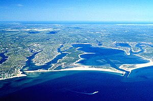 Waquoit Bay National Estuarine Research Reserve - An aerial view of the jetties extending out from the entrance of Waquoit Bay