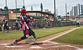 Nicholas Clark, a retired U.S. Soldier and a member of the Wounded Warrior Amputee Softball Team (WWAST), hits a ball during a game against the Navy Commanders at Joint Base Pearl Harbor-Hickam, Hawaii 130110-N-WX059-144.jpg