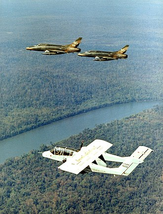 Forward air control during the Vietnam War - A U.S. Air Force North American OV-10A-30-NH Bronco in flight with two North American F-100C Super Sabres of the 136th Tactical Fighter Squadron