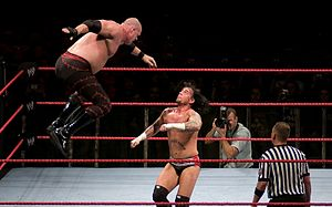 Professional wrestling aerial techniques -  Kane performing a flying clothesline on CM Punk.