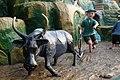 Ox helping out in the field, Haw Par Villa (14793993145).jpg