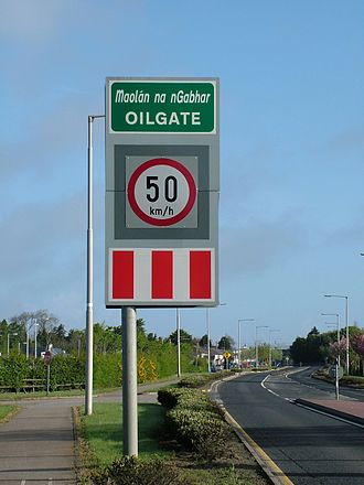 Oylegate - The road sign leading into Oilgate, showing official spelling.
