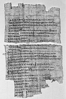 Black and white photograph of a fragment of papyrus with Greek text