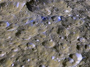 Rings of Rhea - Fresh blue ice at Rhea's equator suggest impacts from deorbiting ring material.