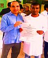 Pakistani ambassador in CUBA delivering MD degree of a recently graduated medical student from ELMA.jpg
